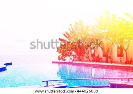 Pool on a tropical beach with color filters - stock photo