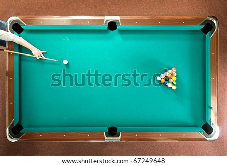 Pool player ready for the break, seen from above - stock photo