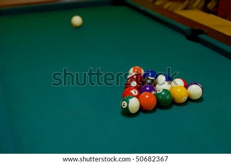 Pool table before the first stroke - stock photo