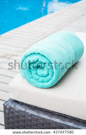 Pool towel on chair decoration around swimming pool in hotel resort
