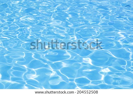 Pool water/Sun reflections in pool water from above. - stock photo