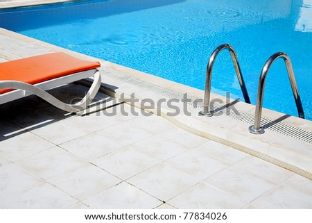 pool with lounge in the tropical resort - stock photo