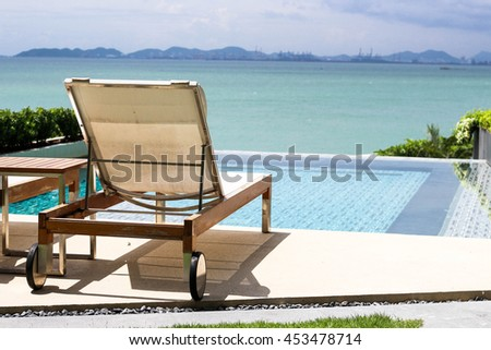 poolBeautiful luxury umbrella and chair around outdoor swimming pool in hotel resort neary sea and beach