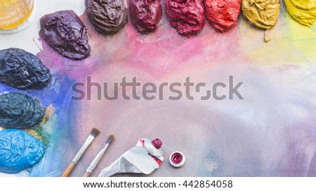 Pooled together and mixing oil paints - stock photo