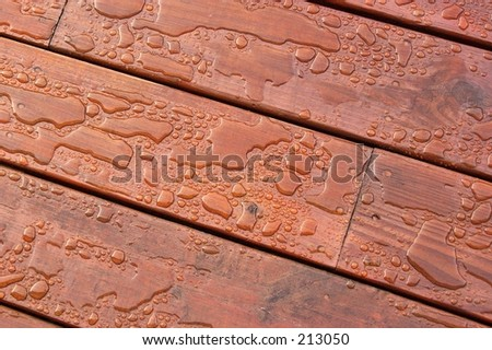 Pooled water on finished deck - stock photo