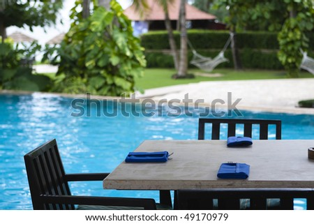 poolside dining table at a summer resort in sanya, hainan island, china.