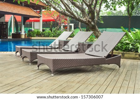Poolside loungers at an exotic asian hotel.
