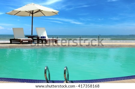 Poolside view near the beach  - stock photo