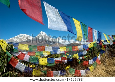 Poon HIll View of Annapurna Range through prayer flags - stock photo