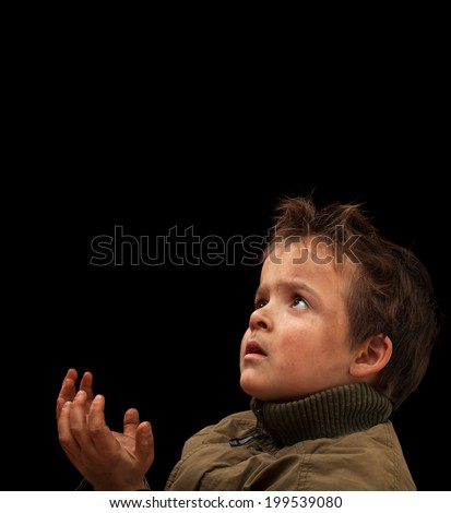 Poor child waiting for a donation - on black background - stock photo