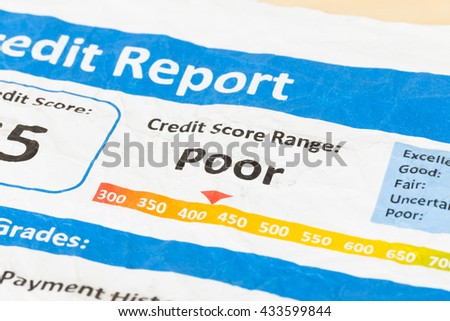 Poor credit score report on wrinkled paper