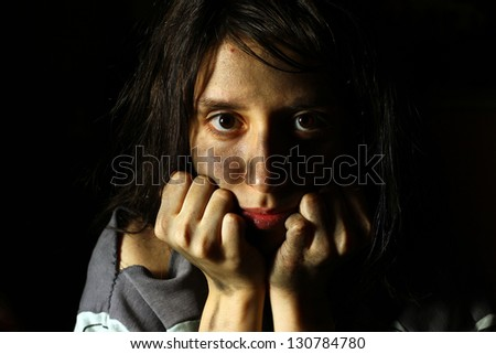 Poor dirty girl looking at the camera - stock photo