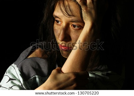 Poor dirty girl staring into distance - stock photo