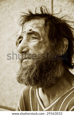 Poor homeless old man. - stock photo