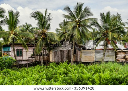 Poor huts of the natives, traditional indonesian poor house. New guinea, Indonesia - stock photo