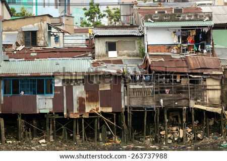 Poor shanty wooden house on the Saigon river bank in Ho Chi Minh city, Vietnam - stock photo