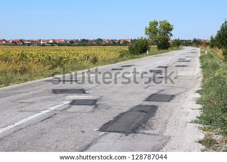 Poorly patched road in Negotin, Serbia. Regional road in Bor district of Serbia. Serbian countryside.