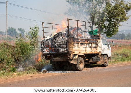 POP PRA, TAK, THAILAND - FEB 09 : Hay truck fire caused by cigarette workers sitting on the roof at KM47, Pop Pra, Tak, Thailand on FEBRUARY 09, 2016.