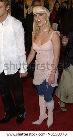 Pop star BRITNEY SPEARS & boyfriend *Nsync star JUSTIN TIMBERLAKE at the world premiere, in Hollywood, of her new movie Crossroads. 11FEB2002.   Paul Smith/Featureflash - stock photo