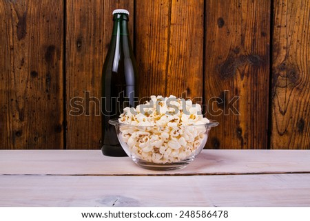 Popcorn and beer  - stock photo