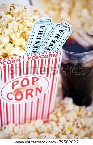 Popcorn and movie tickets - stock photo