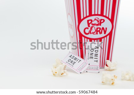 Popcorn and two tickets - stock photo