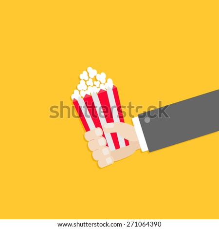 Popcorn. Businessman hand. Cinema icon in flat design style.  - stock photo