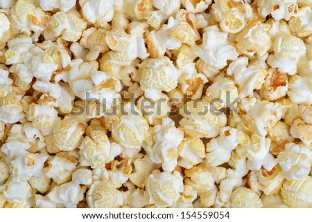 Popcorn close-up on whole background - stock photo