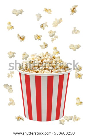 Popcorn falling in striped bucket on white background