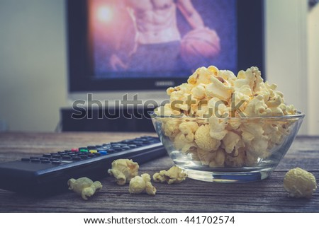 Popcorn for watching football on live Television. - stock photo