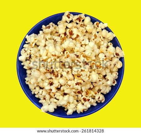 Popcorn in a blue plate closeup - stock photo