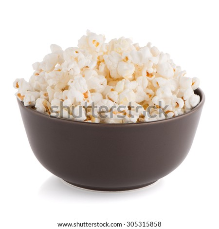 Popcorn in a brown bowl on a white background - stock photo