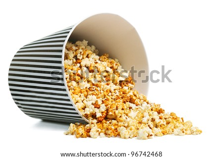 Popcorn in a container on white background - stock photo