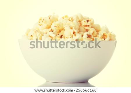 Popcorn in a white bowl. - stock photo