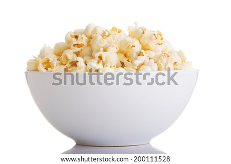 Popcorn in bowl, isolated on white - stock photo