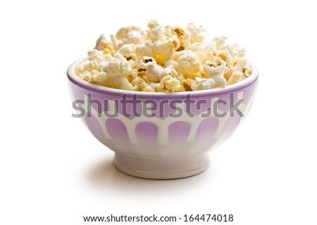 popcorn in ceramic bowl on white background - stock photo