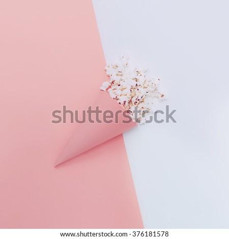 Popcorn in paper envelope. Minimalism Design - stock photo
