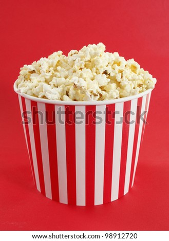 Popcorn in red and white cardboard box for cinema - stock photo