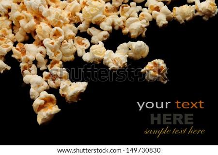 popcorn isolated on black background - stock photo