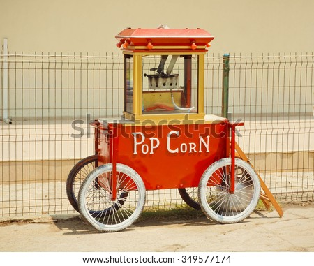 Popcorn machine made in vintage style, with sign Pop Corn on it front - stock photo