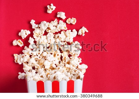 popcorn on a red - stock photo