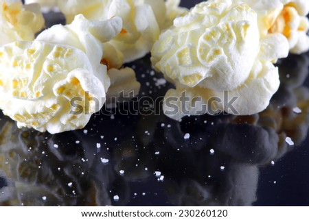 Popcorn on Black - stock photo