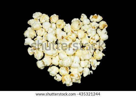 Popcorn on the black background. - stock photo