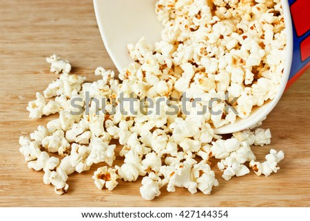 Popcorn on wooden background selective focus - stock photo