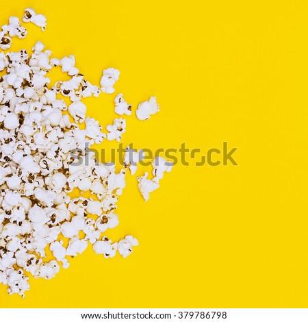 Popcorn on yellow background. Minimalism Fashion detail. - stock photo