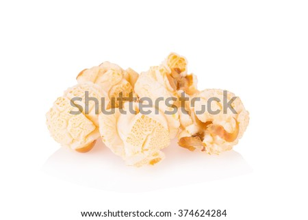 Popcorn pile isolated on white. - stock photo