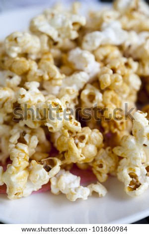 popcorn pop. A variety of corn, Zea mays everta, having hard kernels that burst to form white, irregularly shaped puffs when heated - stock photo
