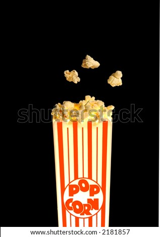 Popcorn popping out of old fashioned container
