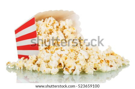 Popcorn spilled from a striped box isolated on white background
