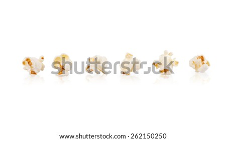 Popcorn spread and arrages on white background   - stock photo